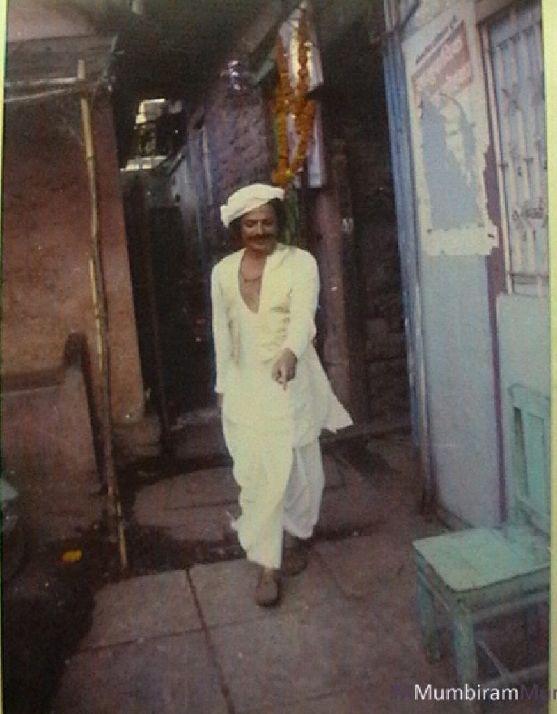 early mumbiram stepping out of his Mandai studio in Pune